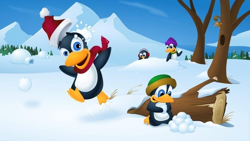 Tux's en la nieve y gorros Navidad